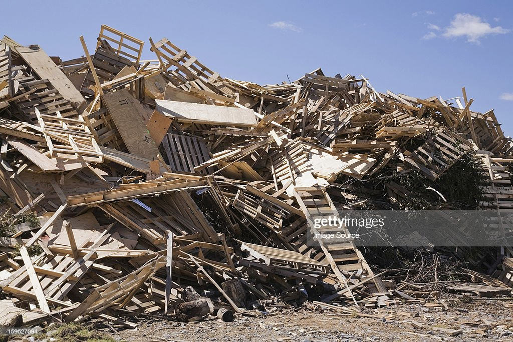 Pile of discarded wood at waste management site : Stock Photo