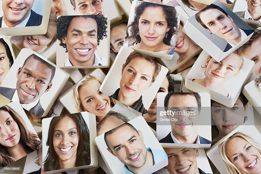 A pile of discs with smiling faces on them : Stock Photo