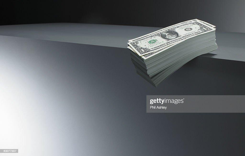 pile of dollar bills on an edge : Stock Photo