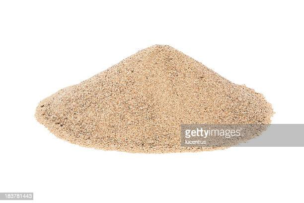 Pile of dry sand on a plain white background