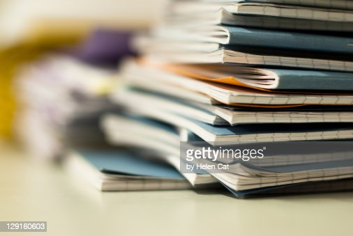 Pile of exercise books