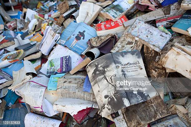 A pile of flood soaked books are piled up outside Bartleby's Books which was flooded during tropical storm Irene on West Main Street on August 31...