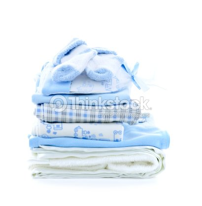 Pile of folded blue and white baby clothes : Stock Photo