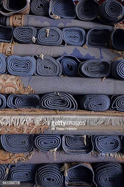 Pile of folded carpets in Mosque