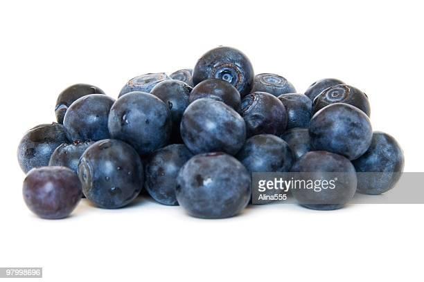 Pile of fresh blueberries on white