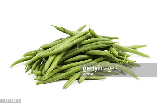 Pile of fresh green beans over a white background