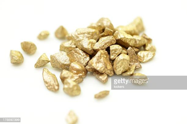 Pile of gold nuggets isolated on white