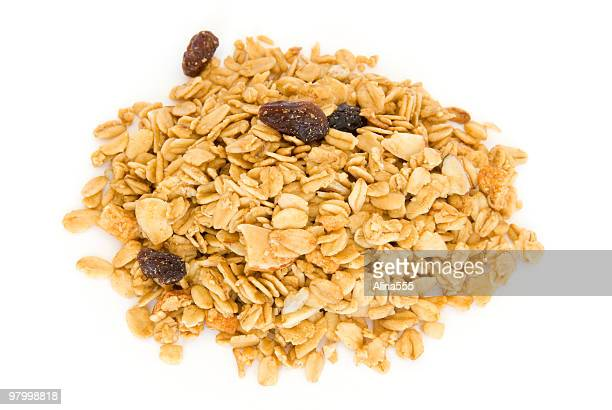 Pile of granola cereal on white