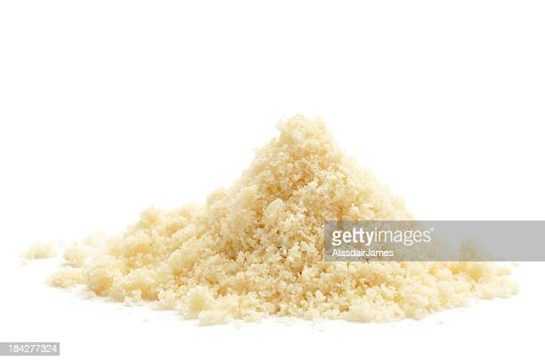 A pile of ground almond on a white background
