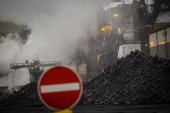 Pile of hard coal in front of an industrial plant on December 04 in Hamburg Germany Photo by Thomas Trutschel/Photothek via Getty Images