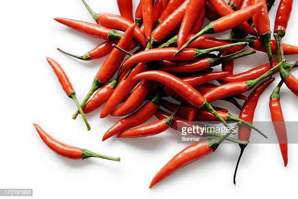 Pile of hot chili peppers on a white background
