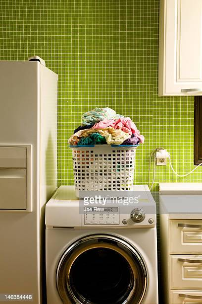 Pile of laundry on washing machine