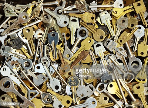 Pile of many different yellow and white old metal keys : Stock Photo