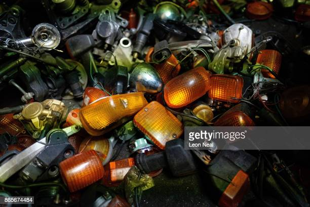 A pile of motorcycle indicator lights are seen among used engine components at 'The Bike Hospital' on October 18 2017 in Johannesburg South Africa...