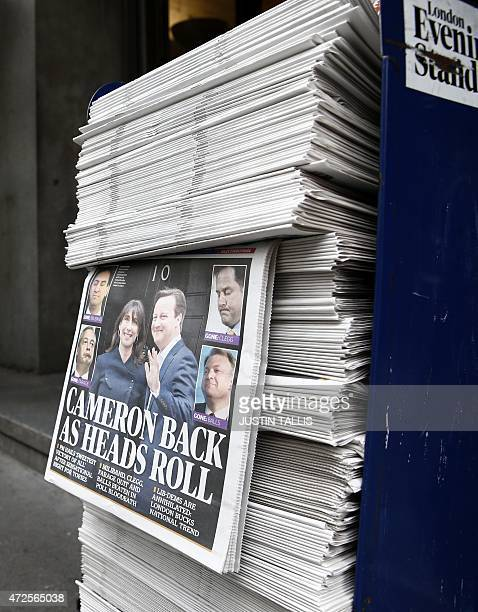 A pile of newspapers showing election victory for British Prime Minister David Cameron's Conservative Party are pictured at a news stand in central...