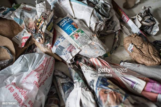 A pile of newspapers used to create alebrijes Mexican folk art sculptures sit at a studio in Mexico City Mexico on Monday Oct 16 2017 The first...