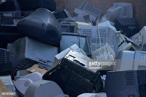 Pile of old computers and television sets at recycling yard