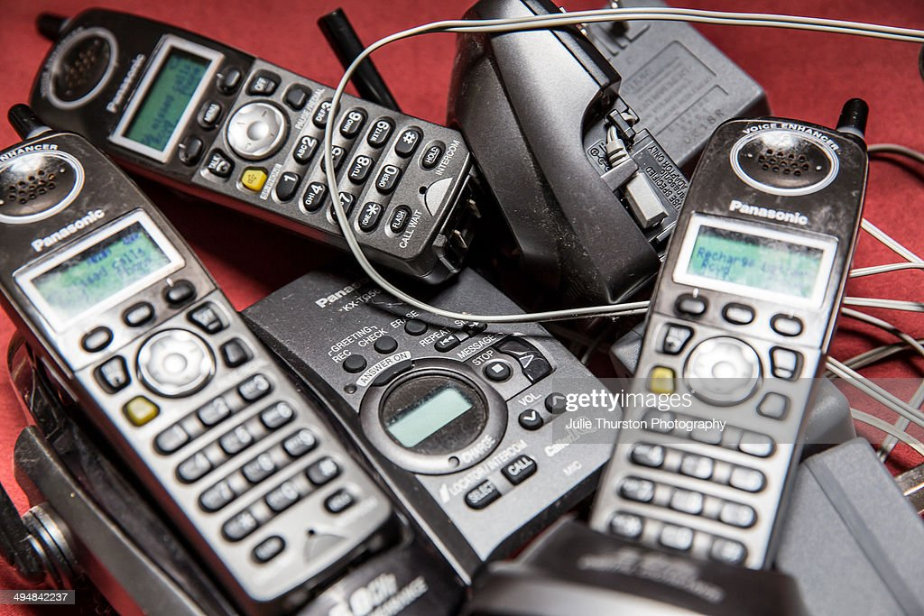 Pile of Old Cordless Style Landline Panasonic Telephones and Their Bases