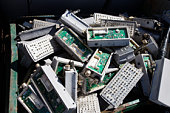 Pile of old electronic components in bin