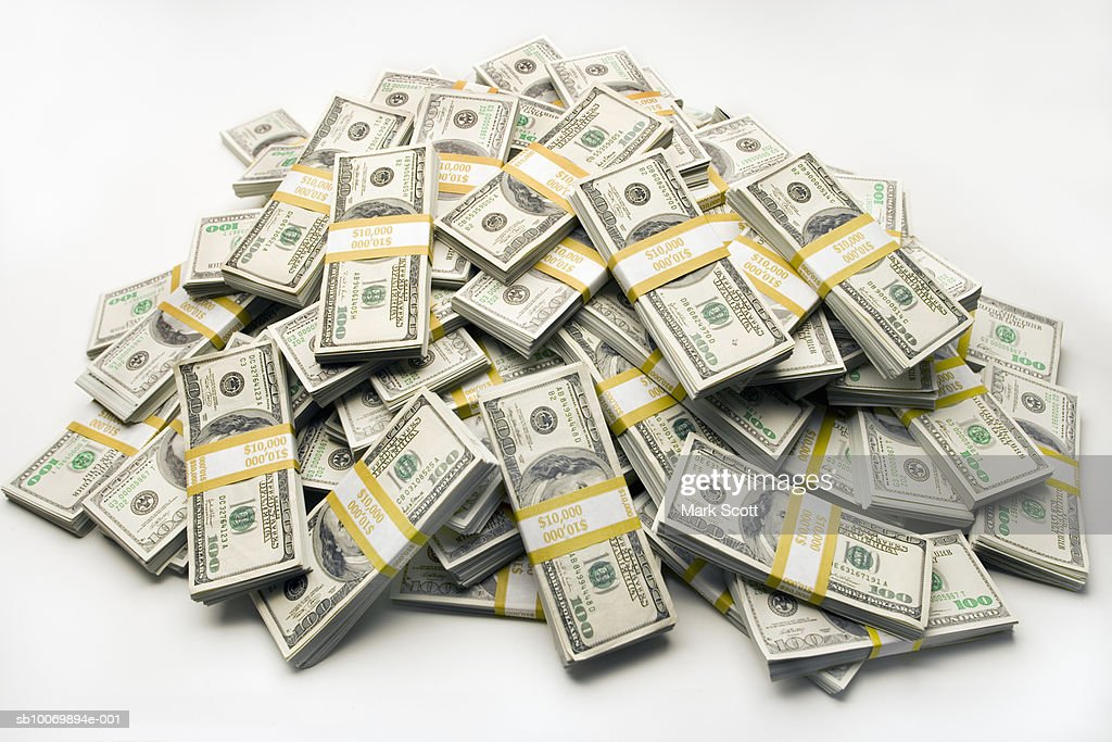 Pile of one hundred dollar bills in bundles : Stock Photo