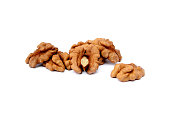 Pile of peeled walnuts isolated with white background