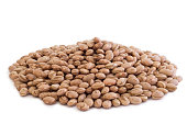 round pile of pinto beans in white background