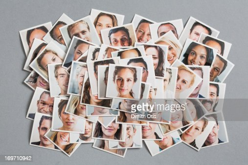 Pile of portrait prints arranged with woman on top