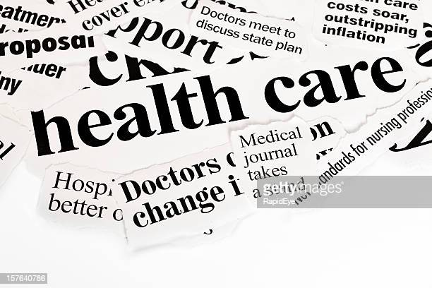 Pile of press headlines covering health care