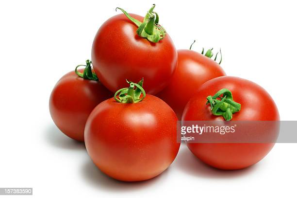 A pile of ripe red tomatoes on a white background