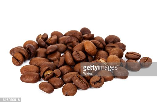 Pilha de grãos de café torrado : Foto de stock