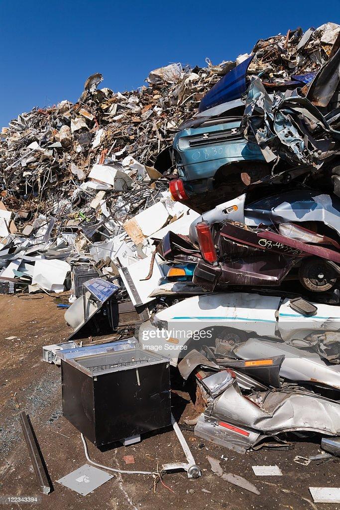 Pile of rusty cars at scrap yard : Stock Photo