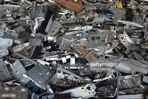 A pile of scrap computer components are piled at a breakage yard where old electrical and electronic items are sold in a district of Abidjan on...
