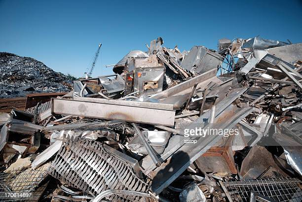 A pile of scrap metal in a junkyard