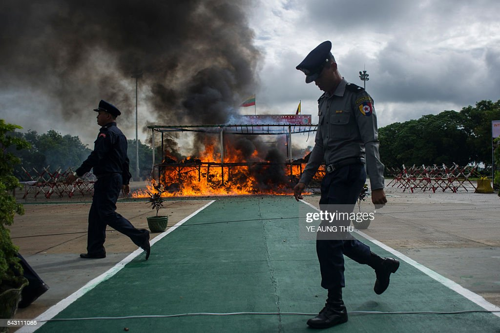 A pile of seized drugs burn after being set on fire during a ceremony to mark the UN's 'International Day against Drug Abuse and Illicit Trafficking' in Yangon on June 26, 2016. Myanmar authorities on June 26 destroyed seized narcotics worth 56.31 million USD in anti-drug ceremonies in Yangon, Mandalay and Taunggyi. / AFP / YE
