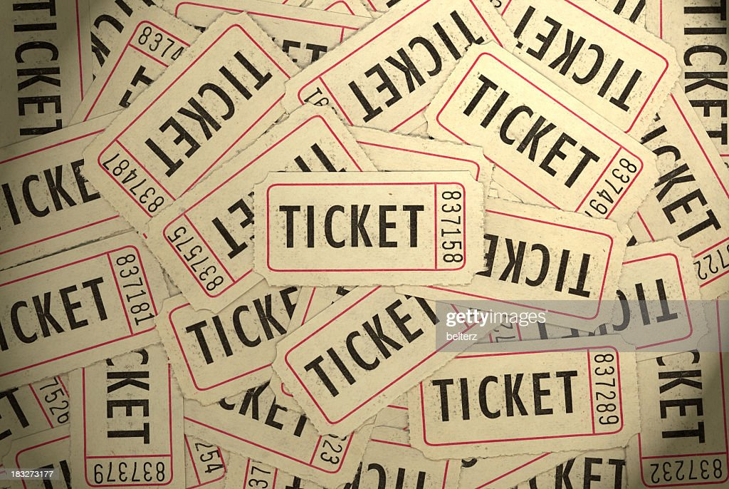 A pile of several white, black and red ticket stubs : Stock Photo