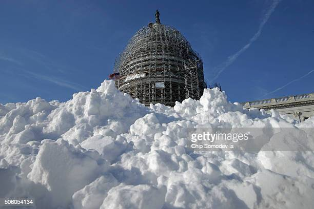 A pile of shoveled snow stands in the plaza on the east side of the US Capitol January 21 2016 in Washington DC One inch of snowfall delayed school...