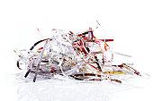 Pile of shredded paper on white background