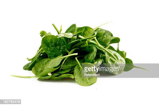 Pile of spinach leaves on a white background