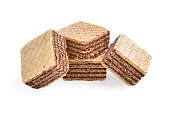 Pile of square wafer biscuits isolated on white backdrop. closeup view