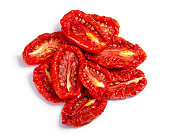 Pile of sundried or dried tomato halves, top view. Clipping paths, shadow separated