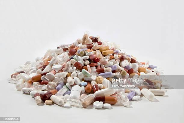 A pile of tablets, pills, and capsules