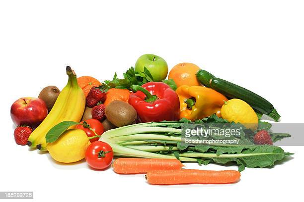 A pile of various fruits and vegetables on white background