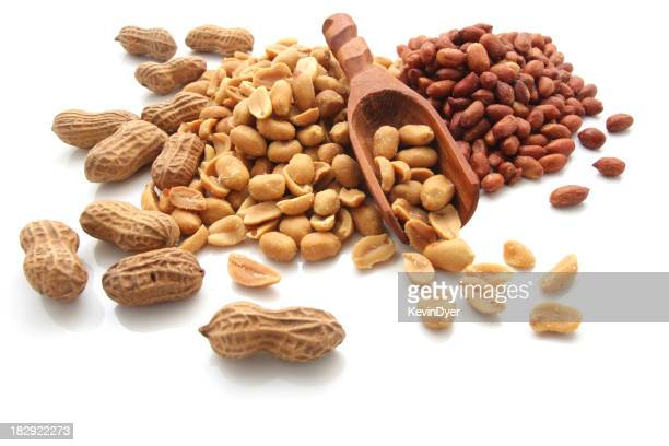 Pile of various types of peanuts and a scoop