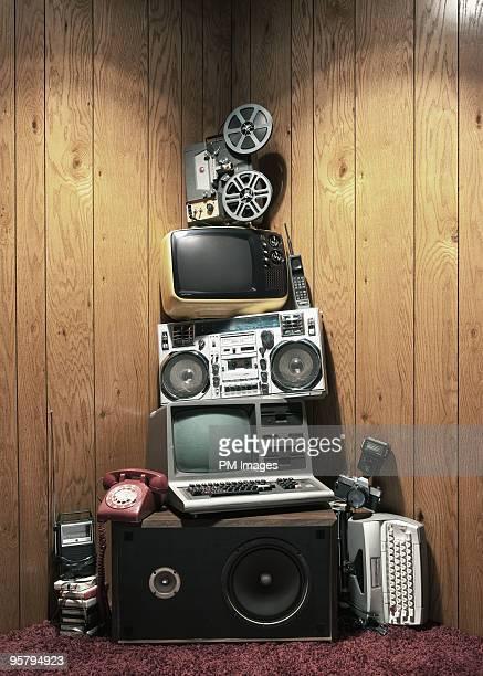 Pile of vintage electronics in corner