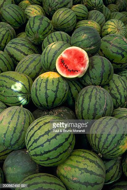 Pile of watermelons with one cut in half (full frame)