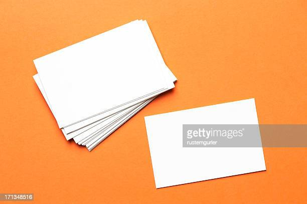 Pile of white notecards on an orange background