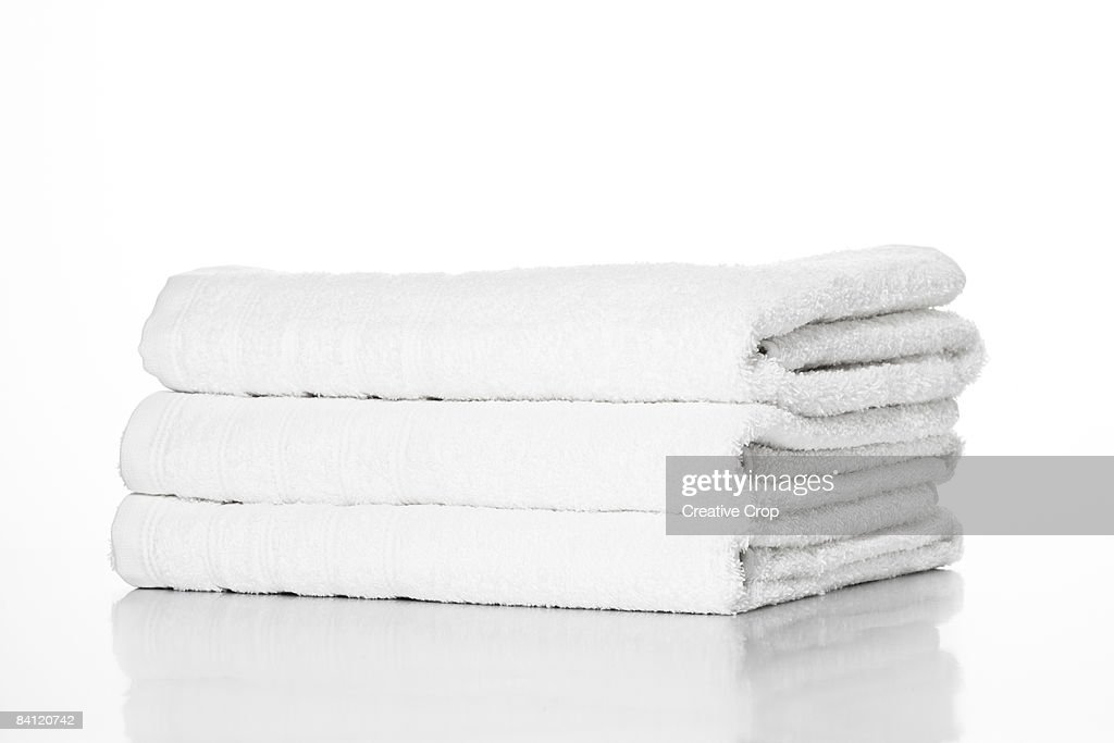 Pile of White towels on White background cut out