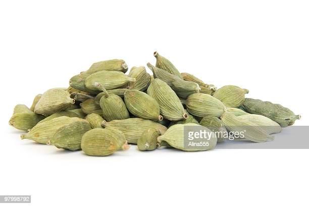 Pile of whole cardamom on white