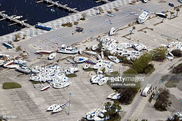 A pile of yachts sit in a parking lot for the marina along Lake Pontchartrain washed ashore by Hurricane Karina September 11 2005 in South Shore...