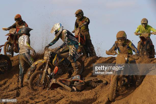 A pile up of riders on the top of a sand dune during the Adult Solo race during day two of the HydroGarden Weston Beach Race on October 15 2017 in...